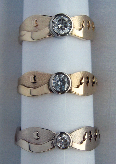 Photo - Samples of Canadian Diamonds in Landscape rings:  30 pt., 22 pt., and 10 pt. (Top to Bottom)